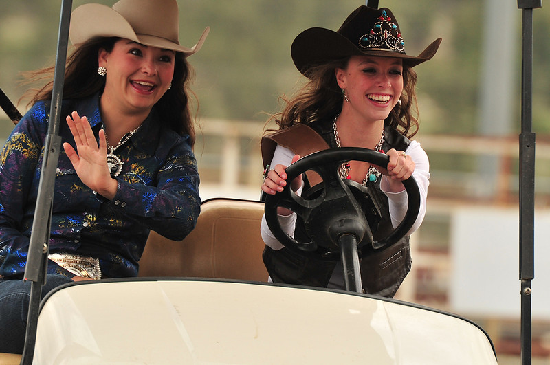 Rodeo royalty Mandi Larson, 18, and Michelle Claypool take a lap around the arena at the Stanley Fairgrounds on Saturday. Claypool is the 2013 Rooftop Rodeo Queen.
