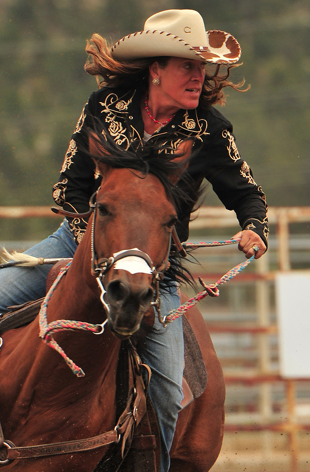 Marti Rushton of Loveland rounds the last barrel and looks for home during Saturday's session of the Beat the Heat Barrel Racing Series. The series consists of four days of competition, two in June and two more in September.