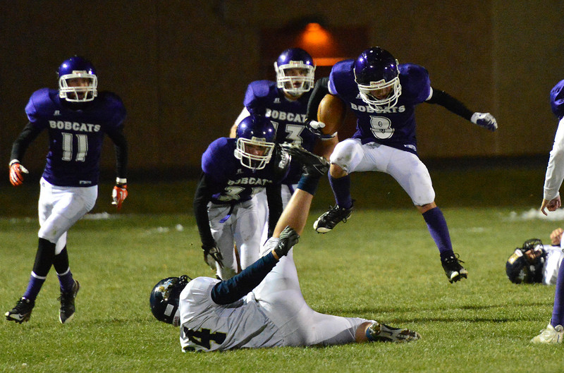 Joseph Coleson hurdles a Nederland player as he returns a Panther fumble on Friday. Coleson finished with five solo tackles and a fumble recovery.