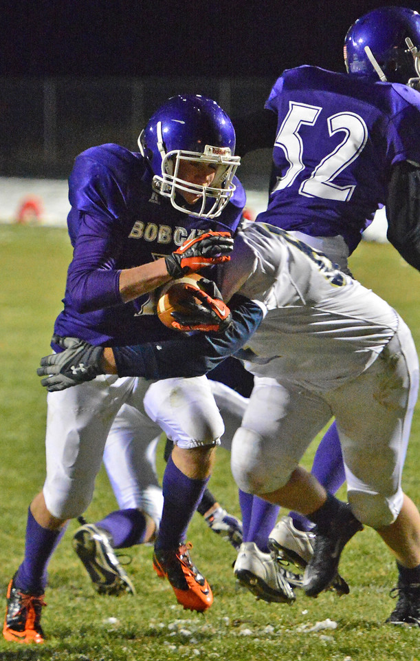 Adam Christenson scores the second of two touchdowns for the Bobcats on Friday. After being down 12-7 in the third quarter, the Estes Park boys took a gutsy homecoming win over visiting Nederland, 28-12, on the strength of their running game and an improving defense.
