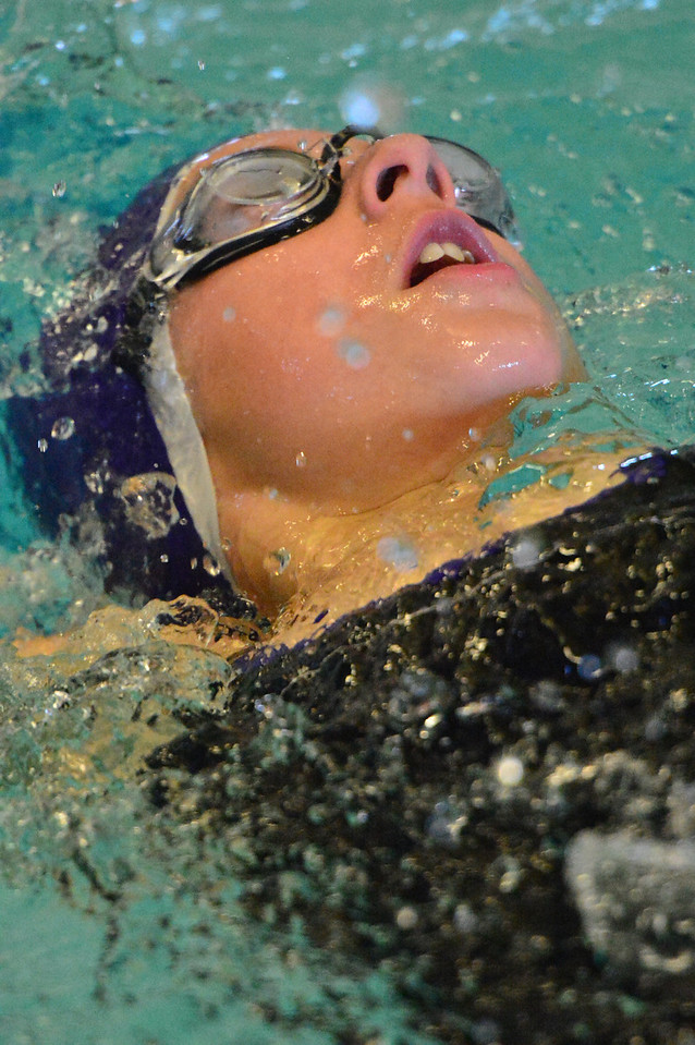 Zoe Hester backstrokes on Saturday. The sixth-grade swimmer cut 10 seconds off of her 100-yard backstroke time.