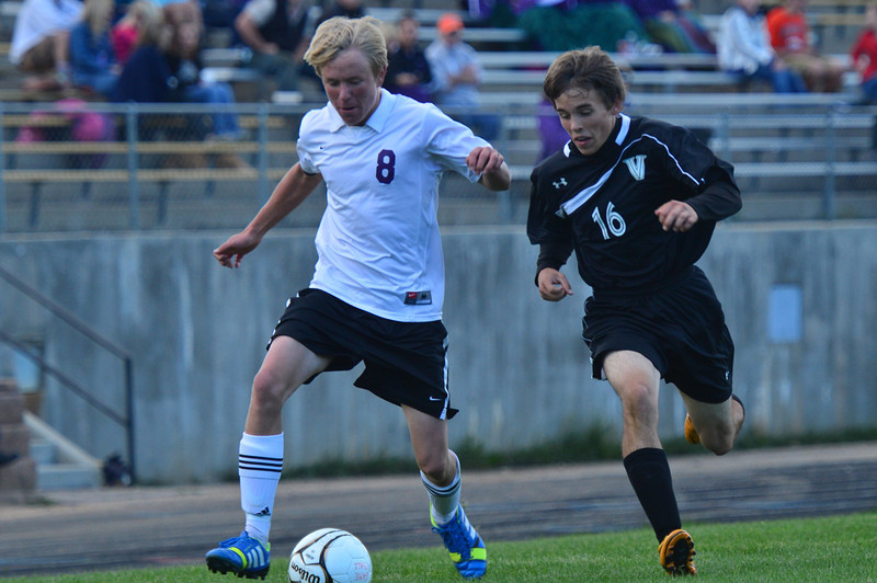 Risto Thompson pushes the ball up the field against the visitors from Valley on Thursday. The Bobcats lost to the Vikings 4-2.