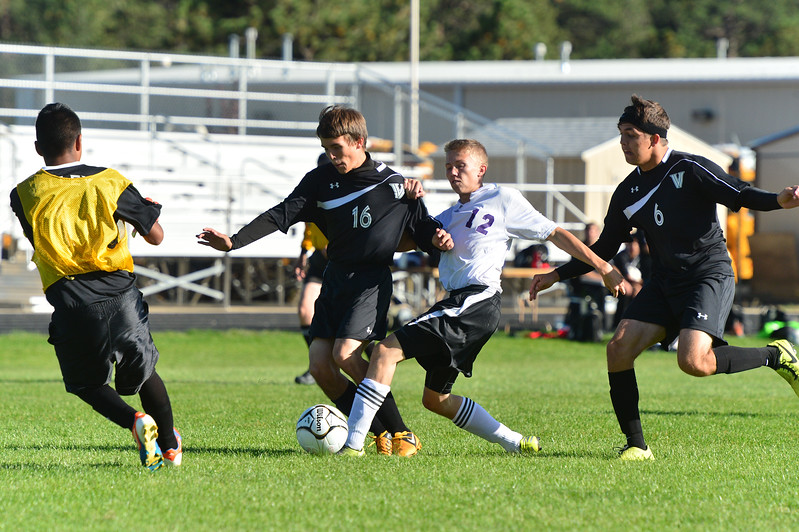 Alex Stevens gets sandwiched by Valley defenders while attacking. The Bobcats lost the match 4-2 to the Vikings.