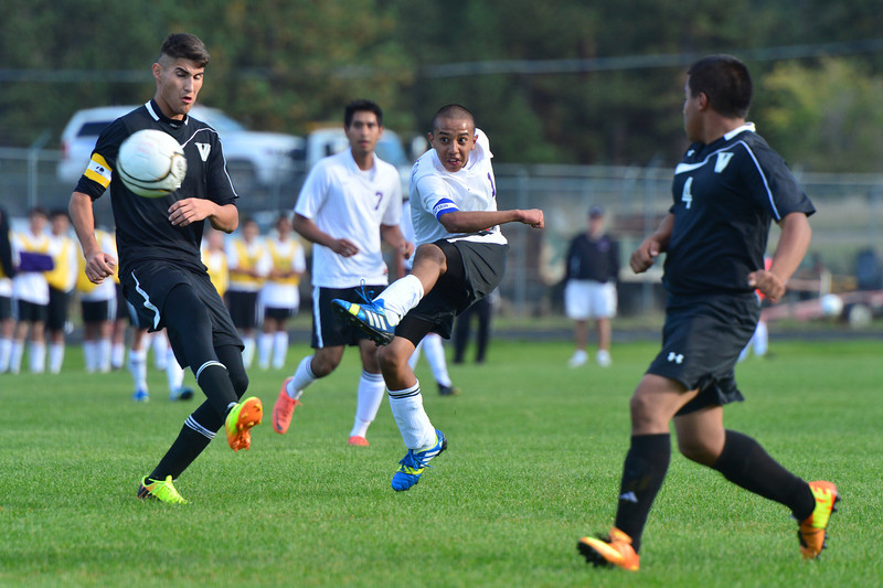 Erick Dominguez shoots in the first half against the visiting Valley Vikings. Dominguez scored the 'Cats' second goal on a penalty kick in the second half.