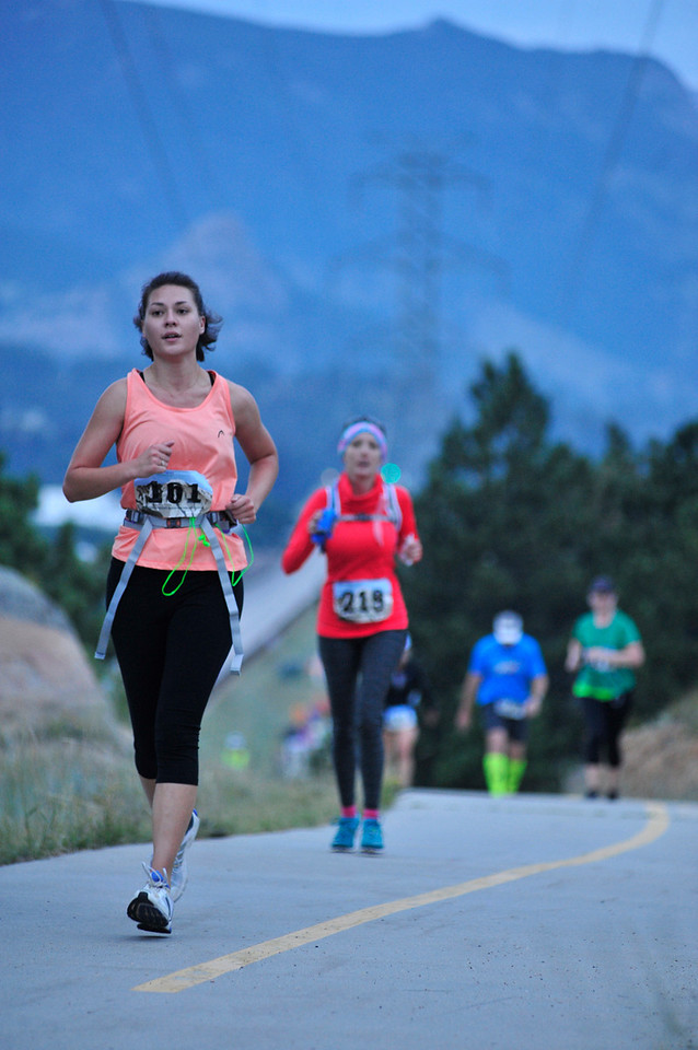 Several women crest a climb before sunrise on Saturday. Two-thirds of the registered racers for the Rocky Mountain Half Marathon were women.