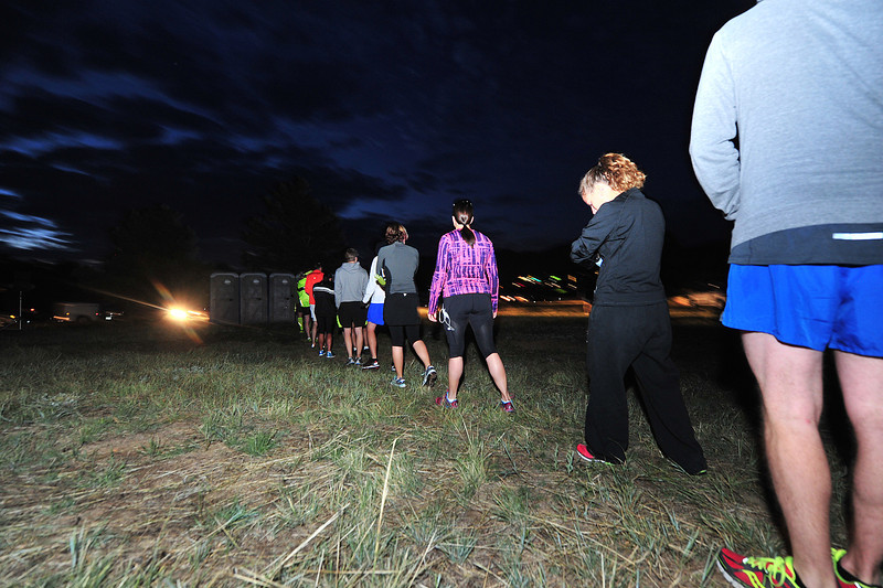Runners line up to take care of last-minute details.