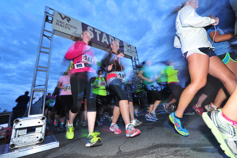 Runners of the first Rocky Mountain Half Marathon get an early start on Saturday's race. Runners started at 6 a.m.