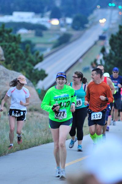 Runners crest the first climb of Saturday's half marathon.