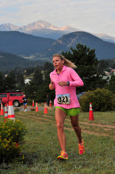 A runner makes the last turn toward the finnish of the Rocky Mountain Half Marathon on Saturday. Two-hundred, ten runners registered for the very first running of the race, due in part to the scenery.