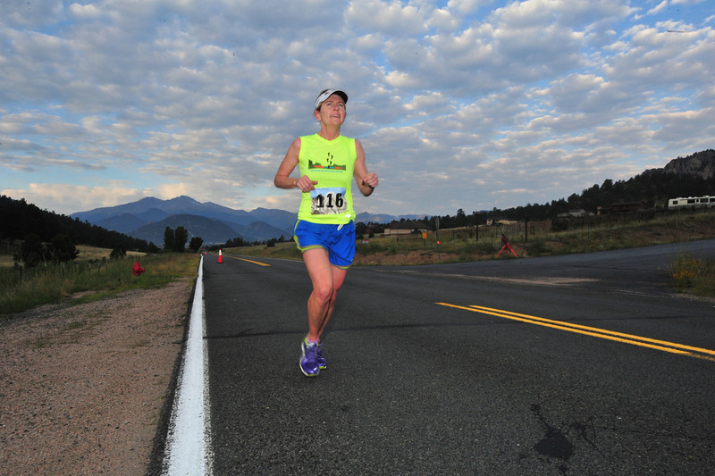 Tanja Cutting slogs up Dry Gulch Road during the first Rocky Mountain Half Marathon on Saturdsay. Cutting was the first woman and third overall during Saturday's 13.1-mile race.
