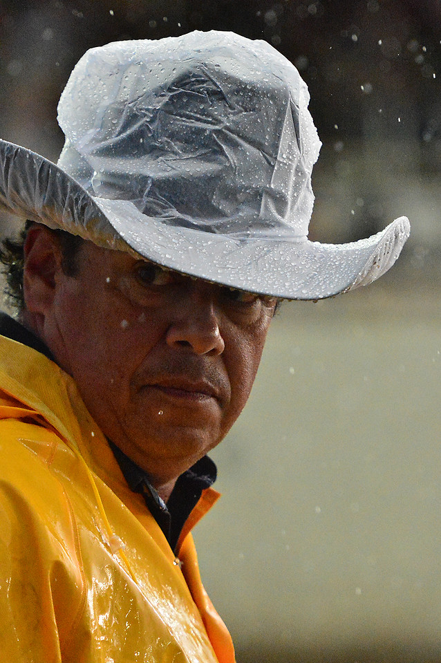 Rodeo committee member Ben Vigil peers through the rain as Saturday's performance began. While rain created challenges for the event, it did not stop the Rooftop Rodeo.