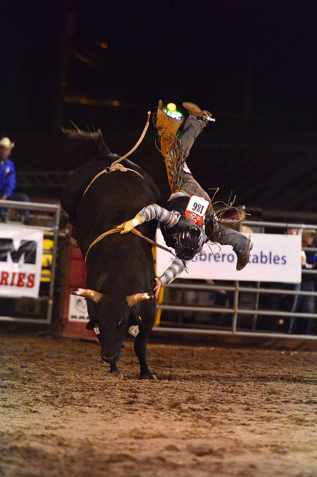 Another cowboy looks for his landing spot on Thursday night. The bulls won on Thursday, with none of the cowboys able to hang on for eight seconds.