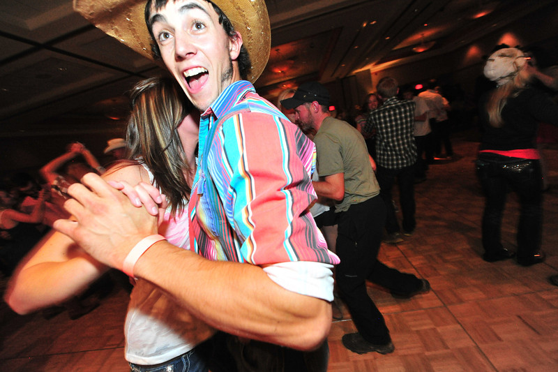Rodeo cowboy and local Ryan Franklin enjoys a dance on Saturday night. The Rooftop Rodeo's Queens' Dance gave contestants, royalty and fans a chance to mingle and kick up their heels.