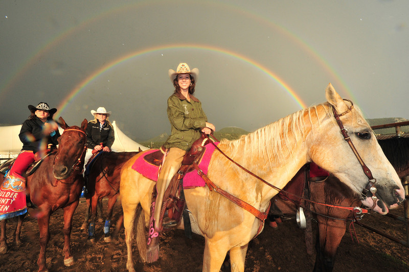 Michelle Claypool, Rooftop Rodeo Queen is also a treasure under Saturday night's rainbow. The July rains returned to soak the fairgrounds and the participants of this year's event.
