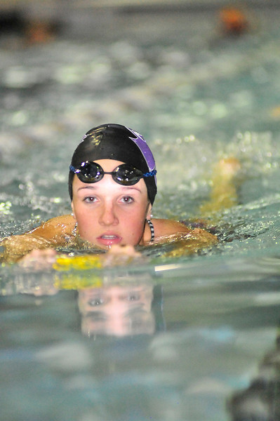 Kate Hewson leads the Ladycat swimmers in warmups on Wednesday. Hewson signed her own Letter of Intent to attend and swim at Western State Colorado University in Gunnison.