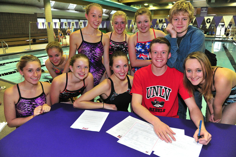 Forrest Beesley is surrounded by a host of Estes Park swimmers as he signs his letter of intent to the University of Nevada-Las Vegas on Wednesday. Beesley received a swimmer scholarship the the Mountain West Conference school.