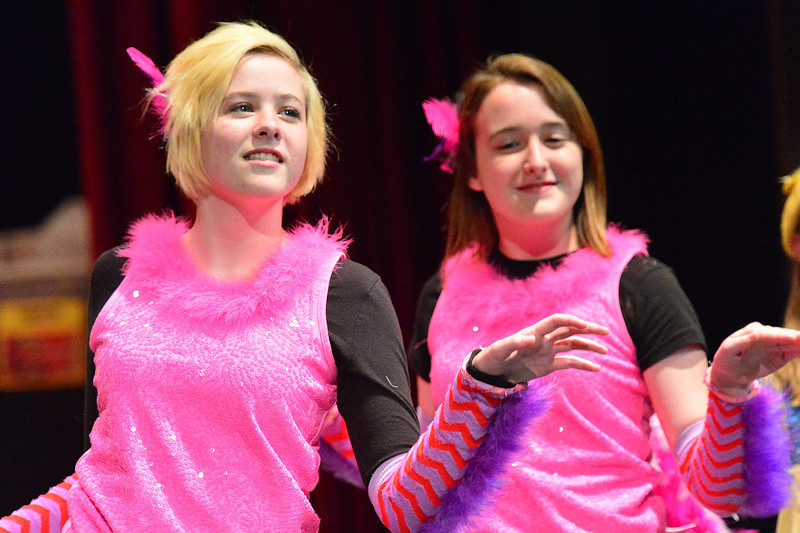 Brightly-colored bird girls dance during the rehearsal of Seussical, Jr.