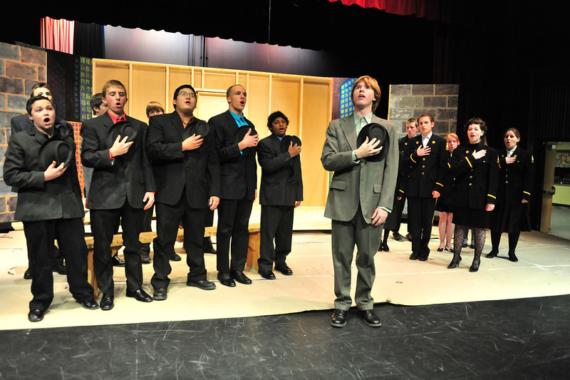 Most of the cast of Guys and Dolls belt out one of the many iconic tunes from the famous musical. The Estes Park High School production runs Friday, November 22 to Saturday, November 23.