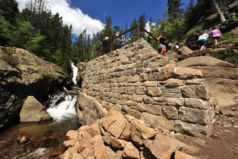 Visitors take a moment or two to enjoy Chasm Falls from the new observation deck on Monday. The stone and concrete deck keeps visitors off the rocks and out of the fast-moving Fall River.