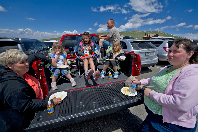 The Perchway and Dawson families of Park Hill Okla. enjoy a truck-bed picnic at the Alpine Visitor Center on Monday. Visitors find many things to do once they make it to the lot at the top of the Old Fall River Road.
