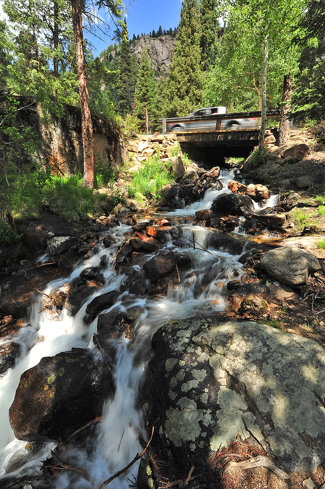 A truck trundles over a bridge along the Old Fall River Road on Monday. While visitors stop for Chasm Falls, many falls and cascades sit along the nine-mile road.