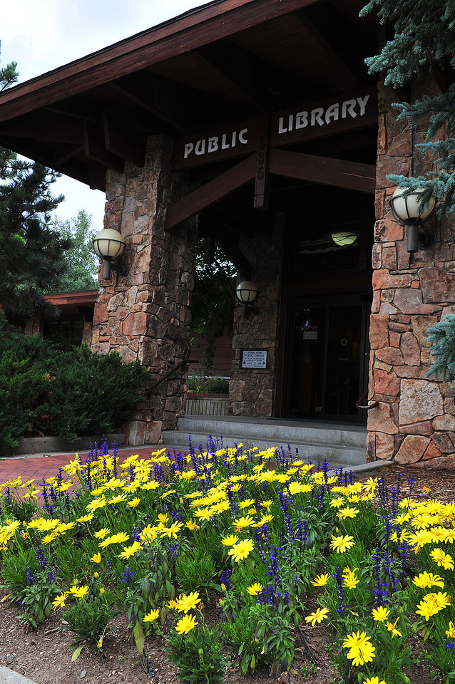 Flower brighten the entrance to the Estes Valley Public Library. Flowers decorate many spots along Elkhorn Avenue.