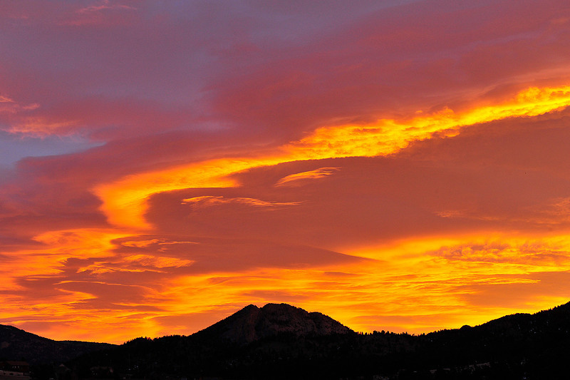 04EP Comm Ear Sunrise.jpg Walt Hester | Trail Gazette<br /> Reds, oranges and pinks stretch across the eastern sky above Mount Olympus on Tuesday. The morning ushered in an unusually warm January day in and around Estes Park.