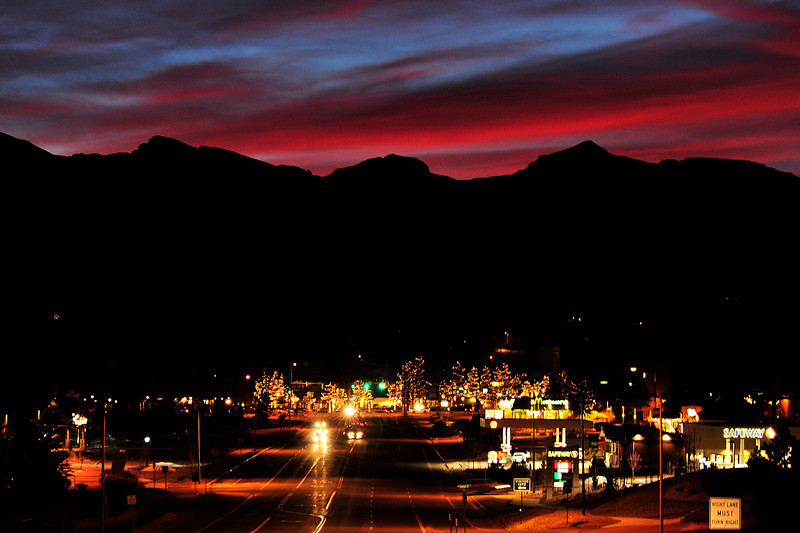 06EP News Lights above and below.jpg Walt Hester | Trail Gazette<br /> A long, slow sunset changes colors in the sky above Estes Park on Wednesday. Typical winter clowds caught and hung on to the color as darkness fell.