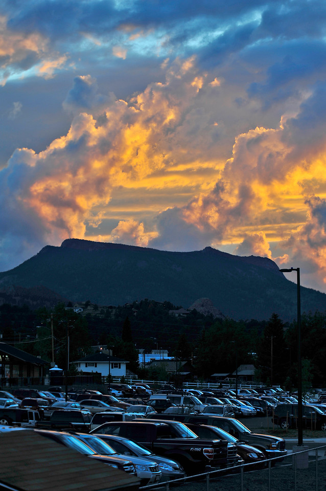 15EP DtBk Sunset over Deer Mountain.jpg Walt Hester | Trail Gazette<br /> Clouds reflect the sunset above Deer Mountain and the Stanley Fairgrounds parking lot on Wednesday. The monsoonal weather pattern tnds to produce spectacular clouds and sunsets in July.