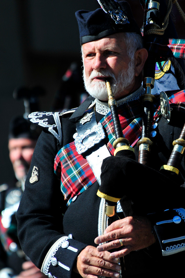 Photo by Walt Hester<br /> A piper from the Pikes Peak Highlander Pipes and Drums plays and marches down Elkhorn Avenue on Saturday during the annual Longs Peak Scottish-Irish Highland Festival. Better known simply as Scot Fest, the three-day festival, along with unusually pleasant weather, attracted huge throngs of visitors from all over the US.