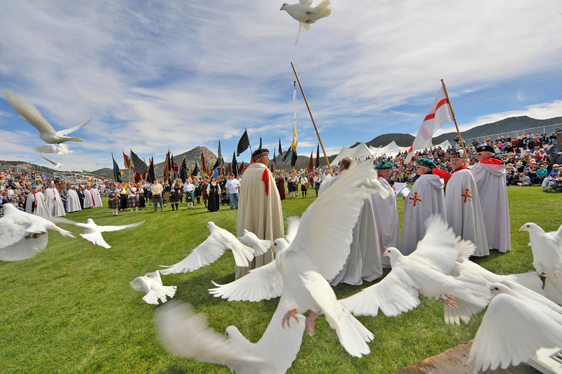 Photo by Walt Hester<br /> Doves fly out of a cage at the Kirking of the Tartans ceremony during the Longs Peak Scottish-Irish Highlands Fesival on Sunday. The ceremony celebrates the clan heritage of Scotland.