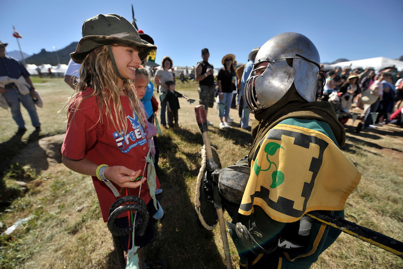 Photo by Walt Hester<br /> Jena Steller, 10, of Highlands Ranch gives her favor to Lord Kiran before the knight begins a close combat demonstration at the Scot Fest on Saturday. The annual three-day-long event celebrates Celtic heratige and history, from medievel combat to comtemperary Celtic rock.