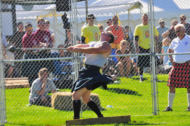 Photo by Walt Hester<br /> Mike Pockoski of Charlotte, N.C. swings the highland hammer during the Professional class of the Highland Games competition at the Scottish-Irish festival at Stanley Park on Saturday. Pockoski won the event by tossing the 16-pound hammer 142 feet, 8 inches.