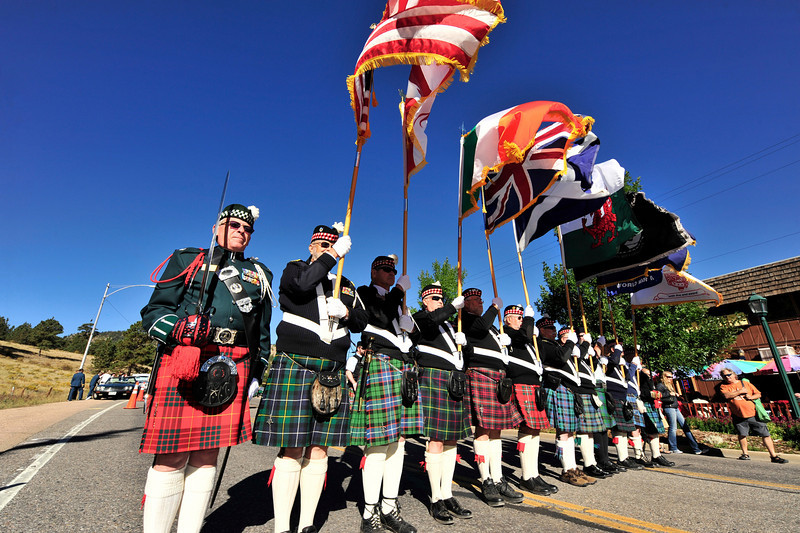 Photo by Walt Hester<br /> The Scottish American Military Society color guard heads the annual parade on Saturday. The color guard carries the flags of four nations, two more Celtic nationalities, the POW-MIA, Colorado, the festival's flag and a flag honoring the service of World War II veterans.