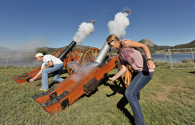 Photo by Walt Hester<br /> Kellen Bochman, left, and Hannah Muse both from Fort Collins fire bowlingball mortors at the Scot Fest on Saturday. The Longs Peak Scottish-Irish Highlands Festival celebrates all thing Celtic, including heavy artillery.