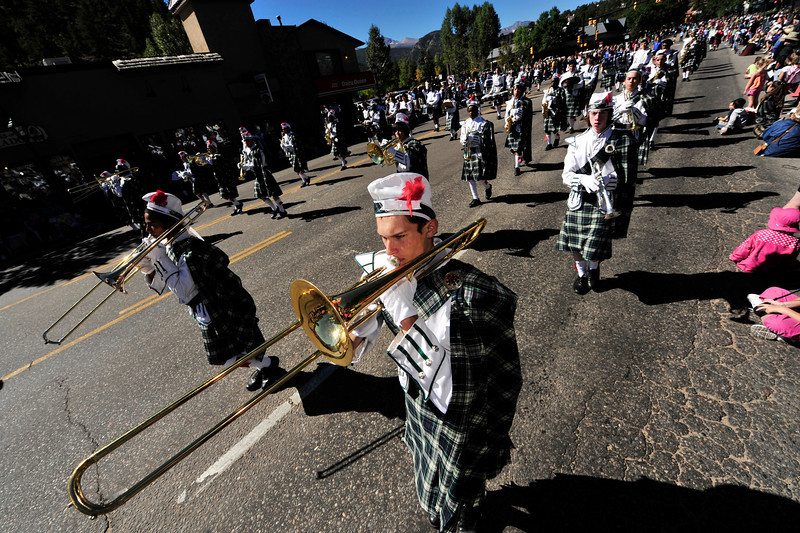 Photo by Walt Hester<br /> The Highland High School marching band plays for Estes Park during the Saturday parade. The Aurora high school has been a part of the parade for many years.