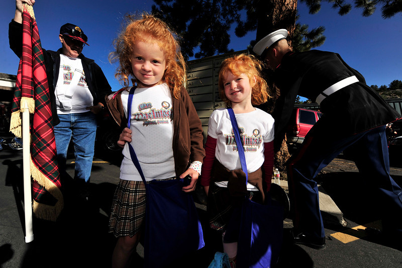 Photo by Walt Hester<br /> Sisters Lindsey, 6, nd Andrea, 4, Frishmuth of Arvada, await the start of Saturday morning's annual Longs Peak Scottish-Irish Highland Festival Parada on Elkhorn Avenue.