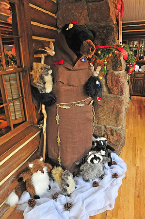 A giant St. Francis teddy bear greets visitors in the main lodge at the Anniversary Inn.
