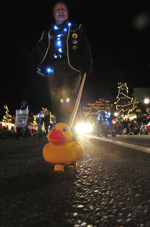 Duck Race volunteers walk their ducks in the Catch the Glow Parade.