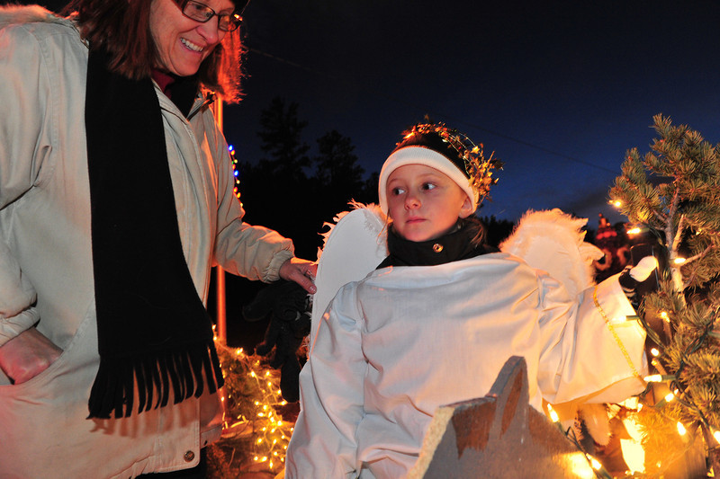 A little angle awaits the start of the annual Catch the Glow Parade. The parade, held the day after Thanksgiving, features floats, fire trucks, the high school's marching band and a popular, large, jolly elf.