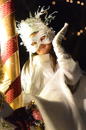 The young winter princess smiles and waves as she heads down Elkhorn Avenue on Friday. A child from the community is picked to portray this spirit of the season, one of the most important characters in the parade.