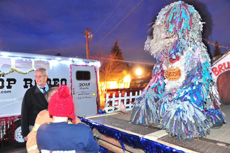 Bruiser, Estes Park's giant rag dog, meets fans before the Catch the Glow Parade on Friday. Some floats change, but many favorites, like Bruiser, manage to make appearances every year.
