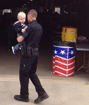 A youngster gets a lift into the May 18 Estes Park Safety Expo at the Stanley Fairgrounds.