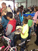 Attendees mill about Saturday at the May 18 Estes Park Safety Expo at the Stanley Fairgrounds.