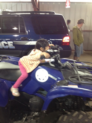 A young attendee takes a seat on a four-wheeler at the May 18 Estes Park Safety Expo at the Stanley Fairgrounds.
