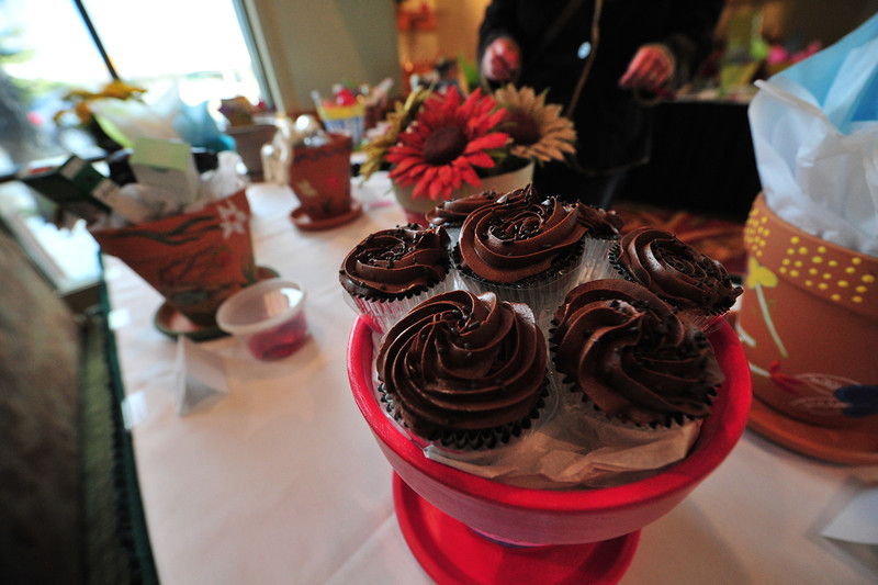 Cupcakes fill a flower pot at the enterance of the Taste of Estes on Thursday. The flower pots were individually decorated and filled, then auctioned off.