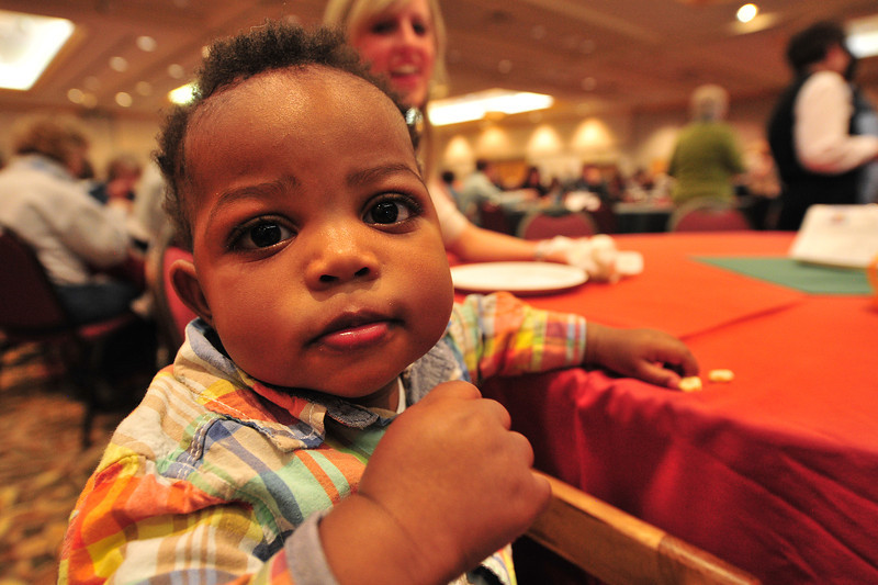 Everett Rosenbaum, 11 month, enjoys some ceriel and seems to long for the goodies at Taste of Estes on Thursday. Pulled pork, cookies, prime rib, eggs, shrimp and brownies were enough to coax anyone to grab a plate and dive in.