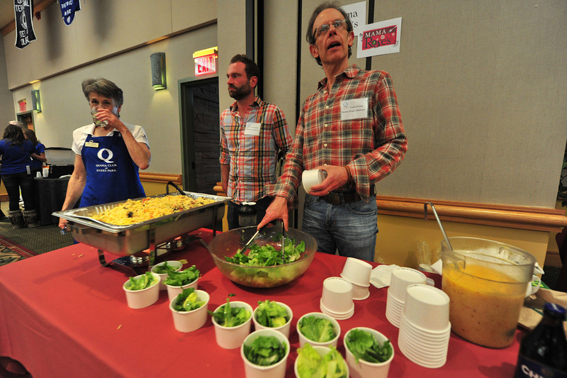 Rob Pieper scoops up salad at the Mama Rose's table at Thursday's Taste of Estes. The event not only raises money for the Estes Park Quota Club, but exposes locals and visitors to the many restaurant's in town.