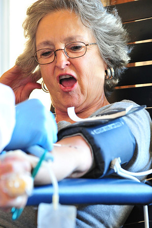 Darlene Homme of Estes Park reacts to the needle stick on Monday. With the exception of the first stick, donating blood is relatively painless.
