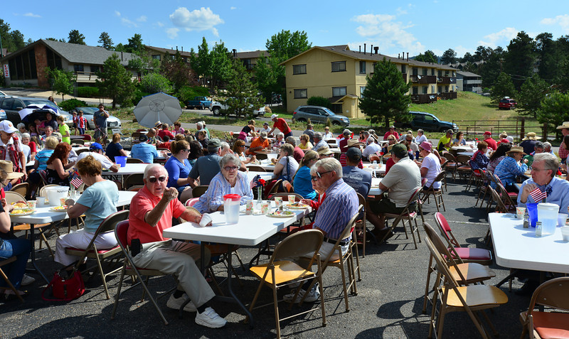 Guests enjoy a pancake, egg and sausage breakfast Thursday morning in the parking lot of the Our Lady of the Mountains Catholic Church. The pancake breakfast was a fund-raiser sponsored for, and to benefit the local Crossroads Ministry.
